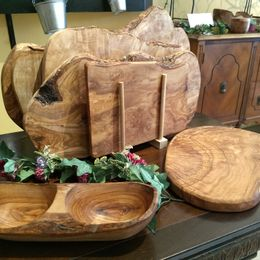Chose from a variety of handmade olive wood cutting boards, utensils and bowls