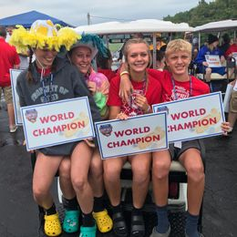 Aidyn Driggers (2nd from right) & Cash Driggers (pictured on right) in the World Champion Parade at 2021 All-American Soap Box Derby at Derby Downs in Akron Ohio.