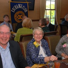 exchange club members enjoy food and drinks