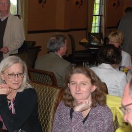 three women sit at table with Exchange Club