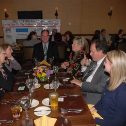 a table of exchange club members enjoy drinks