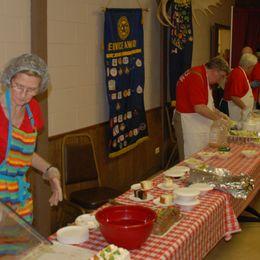Tri Cities Exchange Club members serve spaghetti to community