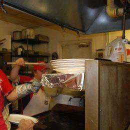 members prepare spaghetti in kitch